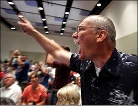 Angry town hall protester