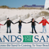 Hands_across_sand_200px